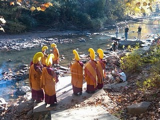 Monks carrying sand to final place, a nearby river